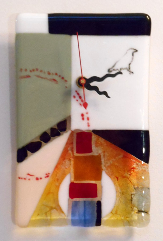 fused glass clock with white & green at top with raven walking off the clock. bottom is warm transparents.